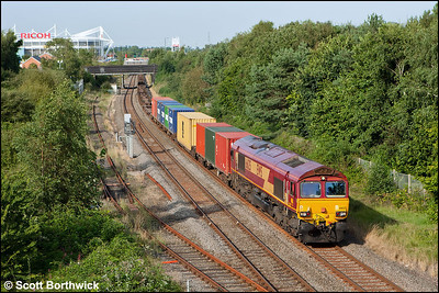 66125 passes Three Spires Jnct, Coventry whilst working 4O30 1319 Trafford Park-Southampton Western Docks on 03/09/2012.