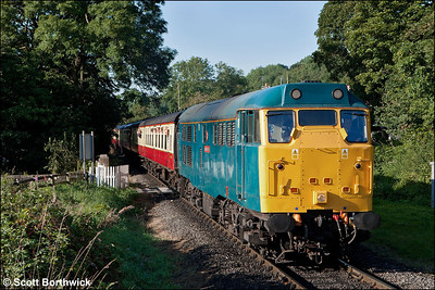 31128 'Charybdis' prepares to exchange the token at Newbridge LC whilst working 1T10 0900 Pickering-Grosmont on 15/09/2012. The train should have run to Whitby, however, a gas leak at Ruswarp had closed the Esk Valley line, so the service terminated at Grosmont.