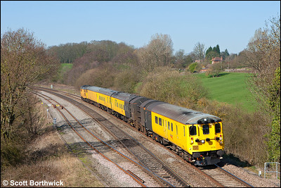 The Structure Gauging Train lead by DBSO 9708 and propelled by 31285 passes Hatton Locks running as 1Q06 0854 Derby RTC-Hither Green Down Recpn on 26/03/2012.