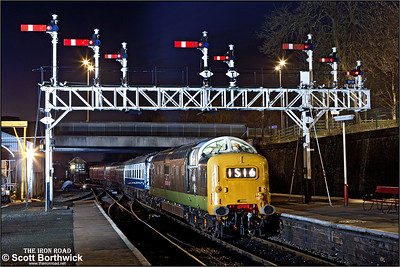 D9016 'Gordon Highlander' passes under the impressive signal gantry at Bury Bolton Street on 16/02/2013.