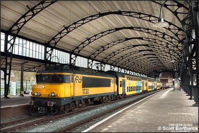 Nederlandse Spoorwegen (NS) Class 1700 electric locomotive, 1730 awaits departure from the bay platforms of  Haarlem's 'Art Nouveau' station with IC3434 1242 Haarlem-Hoorn on 29/04/2015.