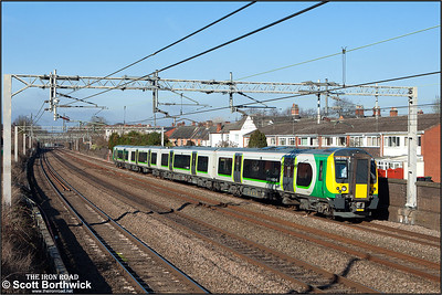 350370 forms 1U28 1102 Crewe-London Euston passing Atherstone on 09/02/2015.