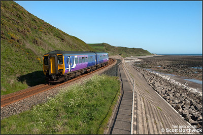 156487 forms 2C43 1533 Lancaster-Carlisle skirting the Cumbrian coast at St Bees on 23/05/2016.