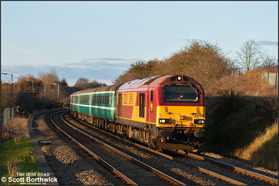 67028 approaches Bermuda Park, Nuneaton whilst working 2T08 1650 Nuneaton-Coventry on 28/02/2016. The service was running in connection with the Wasps v Harlequins rugby union match at the Ricoh Arena.