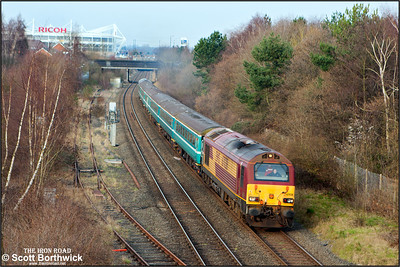 67028 heads 2T08 1540 Nuneaton-Coventry with 67005 'Queen's Messenger' on the rear passing Three Spires Jnct, Coventry on 12/03/2016  The train was running in connection with the Aviva Premiership rugby union clash between Wasps and Leicester Tigers at the Ricoh Arena.