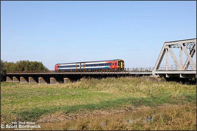 158777 crosses the Welney washes at Pymore whilst forming 1L07 0852 Liverpool Lime Street-Norwich on 18/09/2019.
