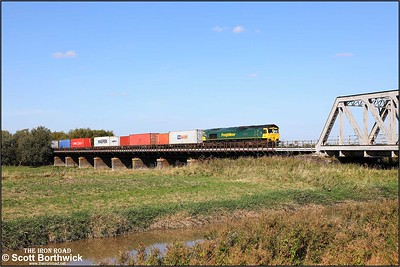 66502 'Basford Hall Centenary 2001' crosses the Welney washes at Pymore with 4L93 1011 Lawley Street FLT-Felixstowe North FLT on 18/09/2019.