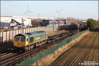 66590 hauls 4M63 0912 Felixstowe North FLT-Trafford Park FLT at Barby Nortoft on 03/01/2020.