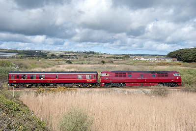 Western D1015 heads past Marazion with one coach running ahead of the steam tour