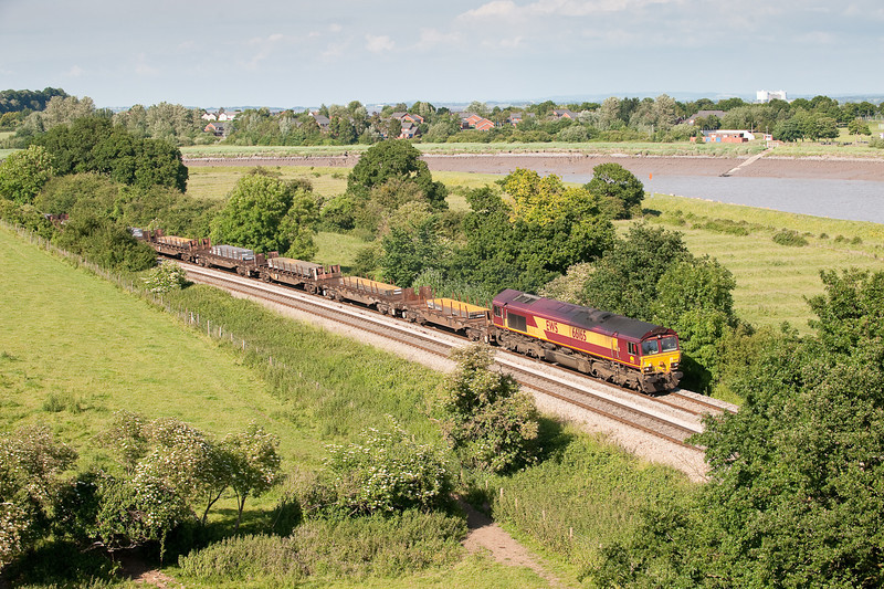 66165 is about to pass under the Severn Bridge with the 6V36  (Q)  08:17 Lackenby-Margam slab train.