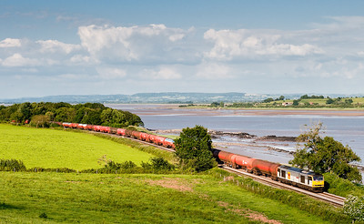 60013 skirts the Severn Estuary near Purton with the 6B47       17:42 Westerleigh-Robeston