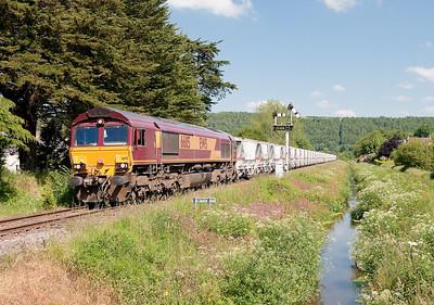 66115 on the MO 1030 Goonbarrow-Fowey seen at St Blazey Middleway crossing
