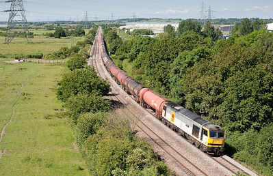 60013 heads the 6B13  05:10 Robeston-Westerleigh under the western span of the first Severn bridge.