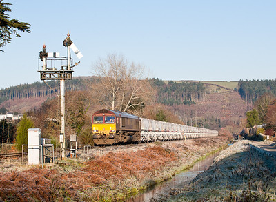 66082 passes St Blazey Middleway crossing with 6G06  MWFO 09:38 Goonbarrow-Fowey