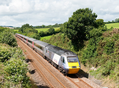 140811  When we left home it was full dull and I just hoped for a bright spot,however the train came in a big patch of blue.Hired in East coast power car 43290 plus XC43303 on 1S55 1135 Newquay to Edinburgh pass Bethany