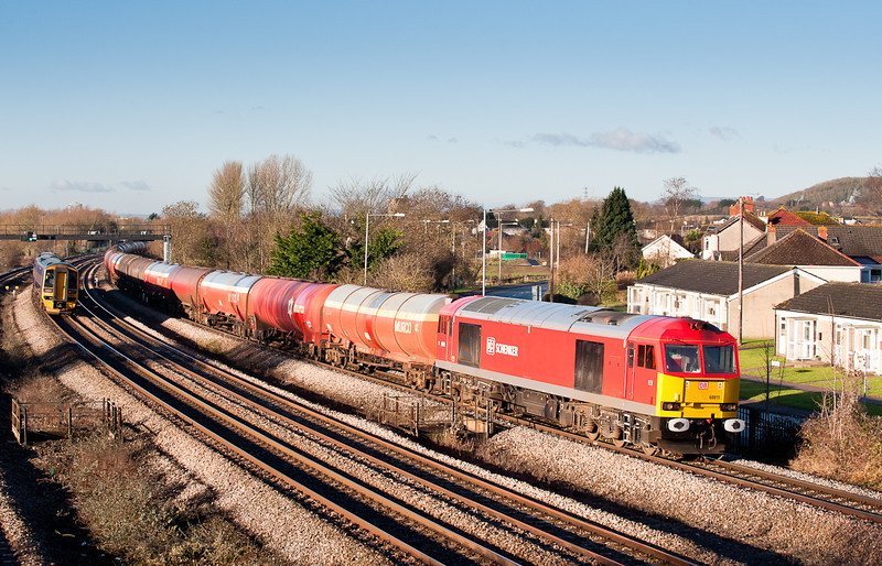 180111  On the first sunny day since its repaint.60011 heads 6B13 round the curve at Magor.....shiny