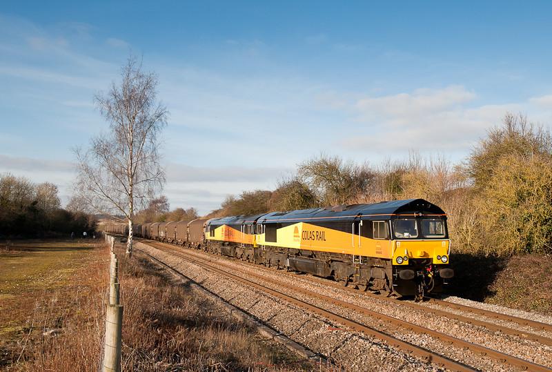66845 and 66844 6O55 13:10 Llanwern-Dollands Moor pass Tetbury road goods yard.