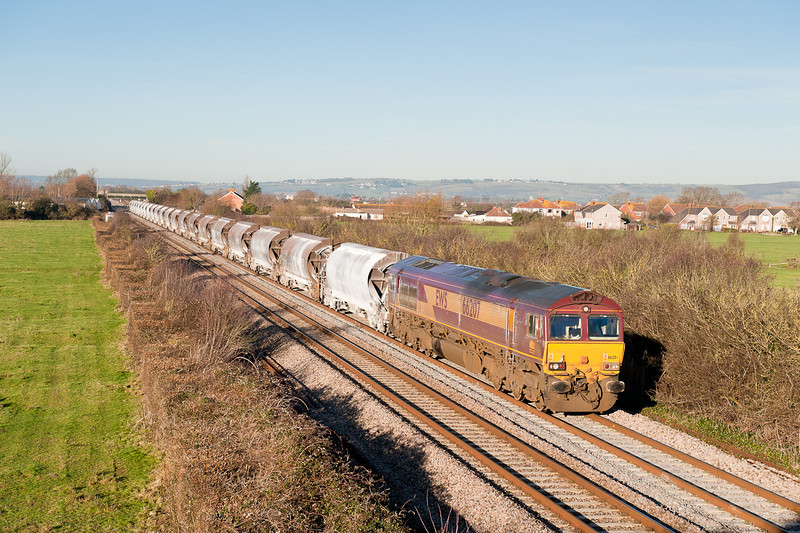 A swift drive from Huntingford and  66207 on delayed  6V99 Worcester-Tavi junct is caught again at Brent Knoll