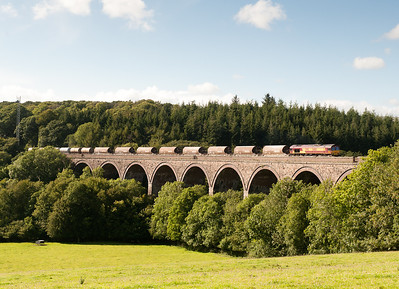 070711 66168 on 6C39  ThO  16:13 St.Blazey-Newport ADJ at Blachford Viaduct.For a change the preceding 125 and Voyager were in the cloud and the sun came out for the freight.