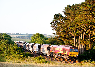 """With the gen groups around its not often you get """"surprised"""" lineside. This was definitely one of these occasions,waiting at Trerulefoot for the sleeper and this turned round the bend. 66043 on 6C99 WO 21:47(Tue) Newport ADJ-St.Blazey running around an hour late."""