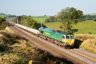 280911 66610 on the 6C16  08:07 Crewe-Carlisle yard round the curve at Docker
