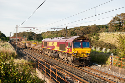 270911 Again unusually heading down the WCML 66167 on the 6K05 12:18 Carlisle yard-Crewe Basford Hall pass Woodacre.