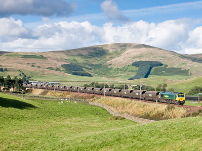 080911  The coal train was obviously in abington loop as it was right behind the Pendolino.At the well known Big T shot 66595 on 6E65 4:33 Ravenstruther-Drax p.s.We wont see the sun for another 6 days!!!!