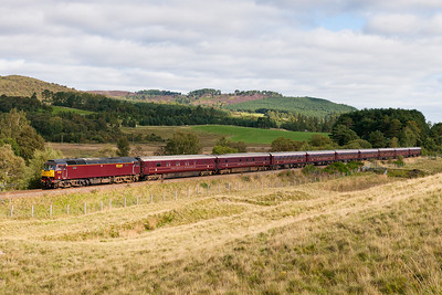 160911 The promised clear start was in fact full dull and it was mid day before we saw any sun.57001 on5H82 1110 Boat of Garten-Kingussie ECS,is seen appoaching Kingussie.