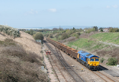 010412  A bonus working for us.GBRF 66718 on the 6Z33 12:09 Cardiff Tidal - Hexthorpe head out of the severn tunnel near Pilning.