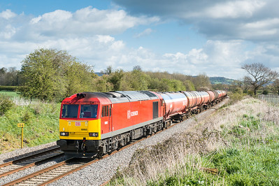 170412  With 6B13 and 6E41 due you really want B13 late and E41 early.Today they were both on time but crucially in the sun.....66063 heads the 6B13  05:05 Robeston-Westerleigh near Coaley