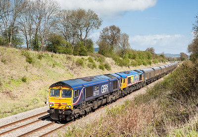 170412  A bit of lineside pruning and the assistant on the tripod.........66723 and 66720 head the 4V94 10:12 Doncaster-Portbury pass Coaley.We tried for the Tavi tanks on the way home but by then there was a lot more cloud/rain /hail around.Still well pleased with our three hours or so at Coaley.