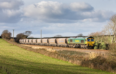 121212  I headed of to a field near Trerulefoot where the sun stubbornly stayed behind cloud until the train came!Whats going on???....66602 working 6C59 11:00 Burngullow to Hackney Yard head downgrade from Trerulefoot to St Germans.Last time I got a full bling shot of the sand in Cornwall was over two years ago so really pleased with this effort,better get back and pick the assistant up!.