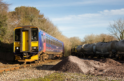111212  153329 comes into Liskeard whilst the cement awaits in the yard to go down to Moorswater