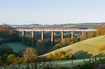 160512  Even in mid May a very clear morning is needed for the sleeper shot.Today there was not a cloud in the sky and 57602 heads the down sleeper over Liskeard viaduct at 0606am. Despite it being mid May there is frost in the valley!!