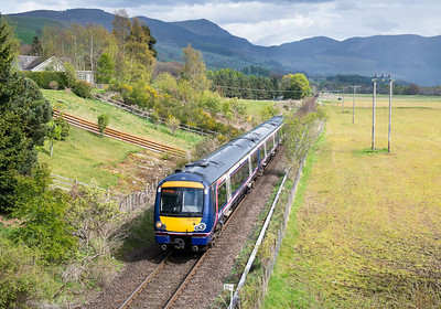 090512 We had just finished a walk in Glen Tilt when minuscule cloud breaks were seen.The DRS intermodal was already in Blair Atholl station but was waiting for the unit to clear the line.170455 heads into Blair Atholl en route to Inverness.