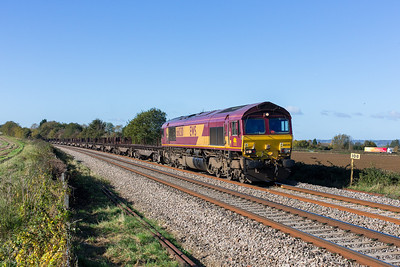 "271012 Last day of the ""summer clocks"" and I thought last chance for 6E 41 at Gossington,this working was a bonus as with the line being shut at Chepstow it came my way.66030 heads the diverted 6E66  10:15 Margam-Scunthorpe past Gossington."