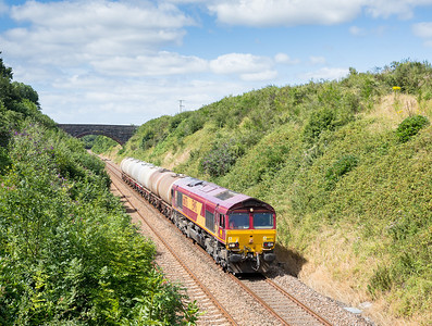 090813  Meantime I had moved 600 yards down the road and yet again met up with the BZ....66075 passes Shillingham,near Forder with an early running 6C39  FO 11:50 St.Blazey-Newport ADJ.It needs to run early for the sun to be on the front so really pleased it all came together (for a change)..You can just about make out the tripod/assistant on the bridge in the background.