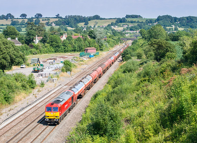 010813  Right behind the container train....... 60062 on 6B33  TThO 13:00 Theale-Robeston passes Chipping Sodbury