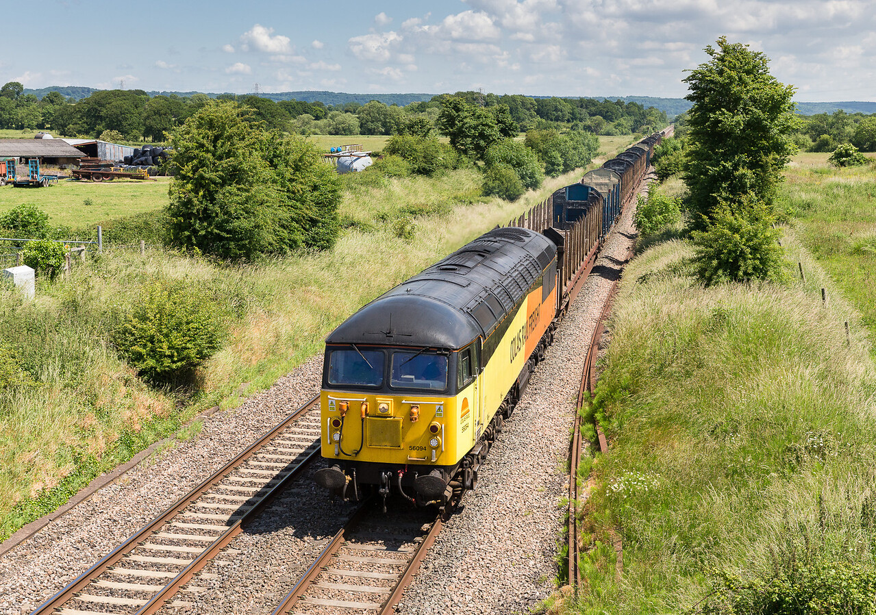 250613 Driving back to the South west we could see a big blue hole near Yatton so a swift detour was made for this....56094 on the 6Z52 07:13 Chirk-Teigngrace pass Ken Moor gate