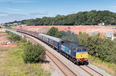 """020913   47818 Top & Tailed with 47501 working 1Z72 07:45 Liverpool South Parkway to Paignton """"The Devonian"""" pass the building site at Barn Owl bridge"""