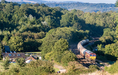 030913  The assistant is high up in the field on the tripod...You could hear the train several minutes before it came into view as with the gradient and its load its working hard...66204 on Dainton bank with 6C62  TO 15:31 St.Philips Marsh-Plymouth