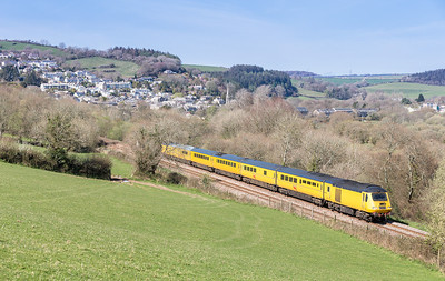 110414  I abandoned the assistant and headed for the spot on Treverran bank.With Lostwithiel in the background 43013/014 glides up the gradient working 1Z40 05:55 Old Oak Common-Penzance