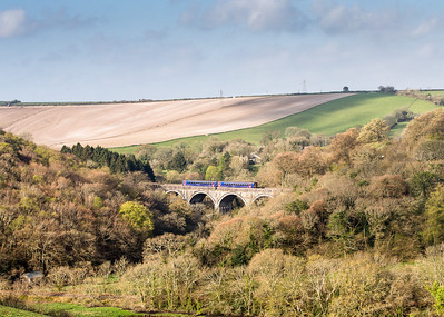 160414  66140 returned light engine from Lostwithiel to Par so an anxious wait was had for the clays going down the branch.Anyway whilst waiting  was well pleased with this shot .0628 Exeter-Par heads over Milltown Viaduct.