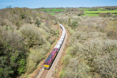 140414  66176 was running early today (nearly 2 hours)  but not early enough,with the sun very head on it is about to pass under the Treffrey viaduct with 6G08 16:29 Goonbarrow-Fowey