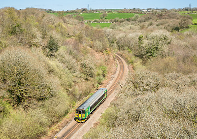 140414  This was a complete surprise and nice to see the London Midland units on the branches...153325 on 1303 Newquay to Par are about to pass under the Treffrey viaduct.
