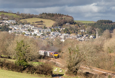 210214 Yes its much the same as 24 hours ago but crucially the light is much better as yesterday it was about to die on me today its getting brighter all the time.66006 heads up Treverran  bank,leaving Lostwithiel behind it.