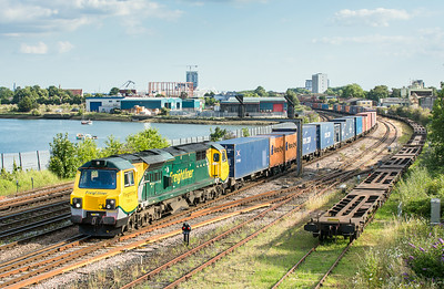 100714  70014 passes St denys with ther 4M98  18:00 Southampton Maritime-Garston
