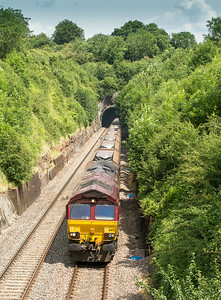 020714   Just before the high clouds takes the edge of the light .....66171 exits Wickwar tunnel with a late running 4V70   MX  05:18 Ratcliffe-Portbury
