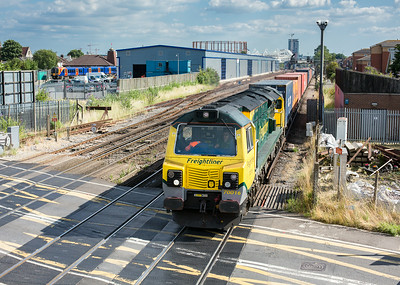 100714  70016  thumps over the crossing at Mount Pleasant with the 4M99  16:57 Southampton-Trafford Park
