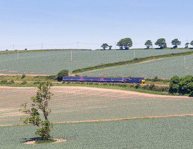 140614  57605 runs through the Cornish countryside between Grampound Road and Trenowth with  5E75 1015 Long Rock - Par ECS.This will then form the 1125 Par to Exeter service.